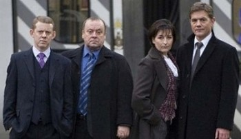 Taggart characters, from left to right: Stuart Fraser (Colin McCredie), Matt Burke (Alex Norton), Jackie Reid (Blythe Duff), and Robbie Ross (John Michie)